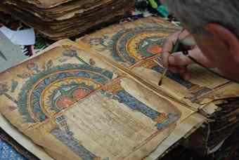 A conservator at work on the Garima Gospels