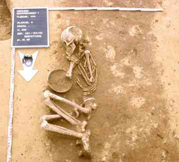 The excavators did not find many complete skeletons. This one was found in the fetal position, and was buried with a bowl.