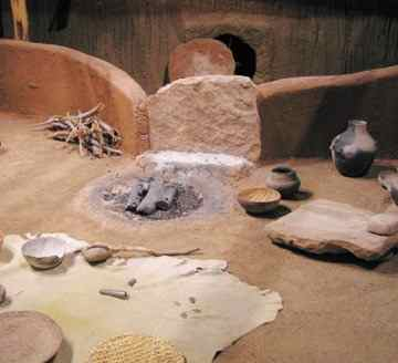 This reconstruction shows what the interior of a pit house at Sacred Ridge might have looked like before the attack.