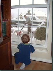 Andrew watching Dad shovel