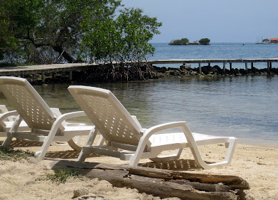 Lounge chairs on the beach on an island in the Islas del Rosario in Colombia