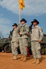 "Squadron color guard members, Sgt. David Wolfe, Spc. David Swan and Cpl. Arthur Fread, all from the 2nd Squadron, 14th Cavalry Regiment ""Strykehorse,"" 2nd Stryker Brigade Combat Team, 25th Infantry Division, from Schofield Barracks, Hawaii, stand at attention during the opening ceremony of Exercise Yudh Abhyas 09 at the Babina Indian army base, Oct. 12. YA09 is a bilateral exercise involving the armies of India and the United States."