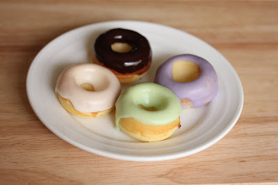 photo of four glazed donuts on a plate