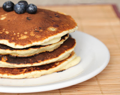 close-up photo of a stack of blueberry pancakes
