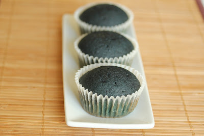 photo of three cupcakes lined up on a plate