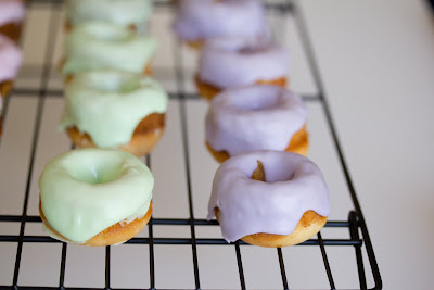 close-up phto of Frosted mini sugar donuts on a baking rack