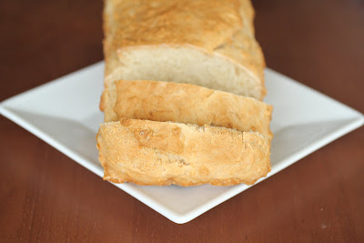 close-up photo of a sliced loaf of honey beer  bread