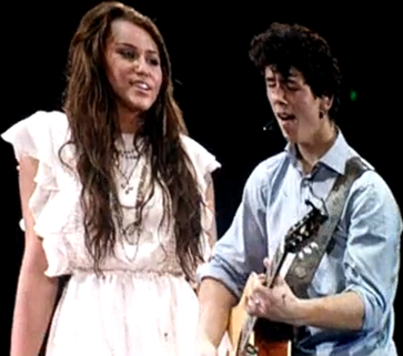 Miley Cyrus and Nick Jonas Before The Storm Live Performance at Jonas Brothers Tour picture