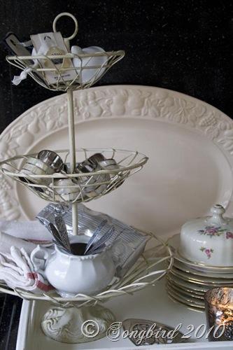 Three tired basket with kitchen accessories3