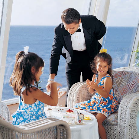 Kids get a giggle out of being served tea in the Palm Court on Crystal Serenity.