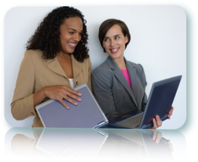 Two women, both holding laptops, smiling.