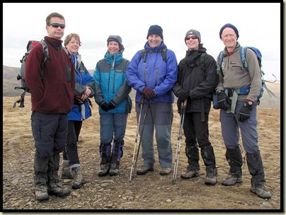 A mottley crew huddle on the spiky 1658 metre summit
