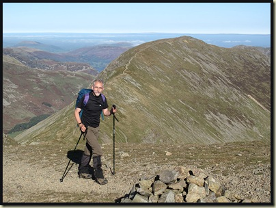 Rick approaches the summit of Fairfield, with St Sunday Crag in the background