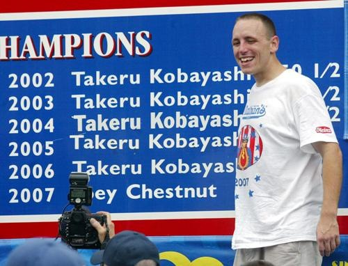 Joey Chestnut of San Jose who defeated six time champion Takeru Kobayashi of Japan  by eating a new world record of 66 hotdogs in twelve minutes at the 91st Annual Hot Dog Eating Contest at Coney Island, 