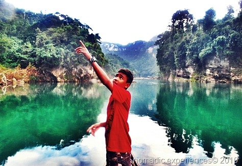 Andoy pointing at the Cave where the bats will fly out