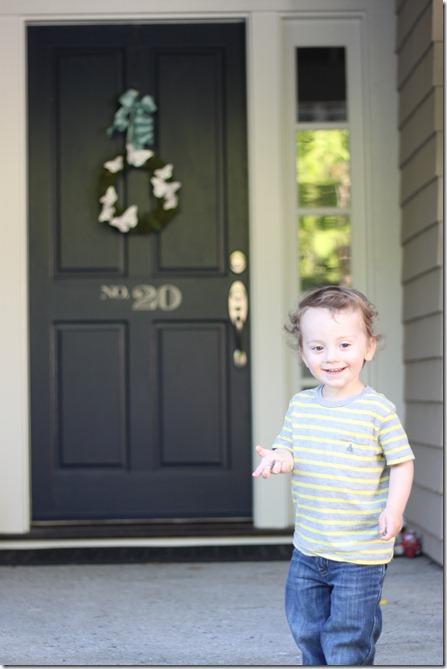 hudson in front of the door