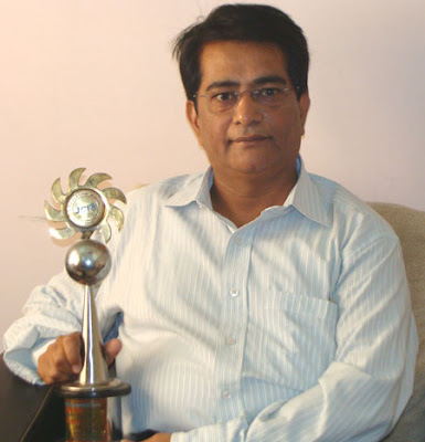 With his Award
