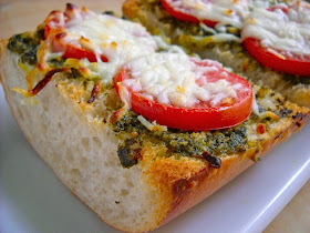 pesto cheese toast topped with pesto, cheese and tomato