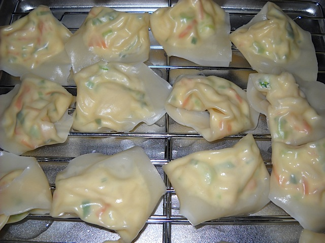 boiled wontons on cooling rack
