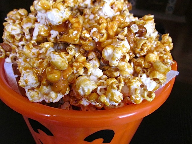 nutty caramel corn close up in pumpkin bowl