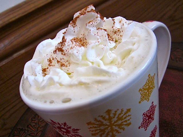 close up of finished tea in mug with whipped cream