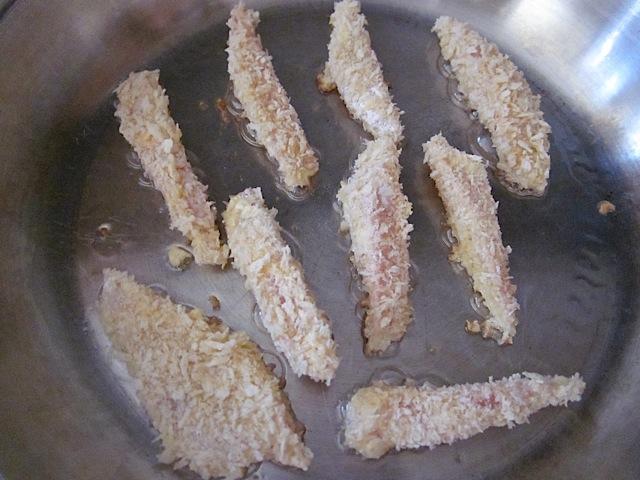 fish sticks being fried in pan
