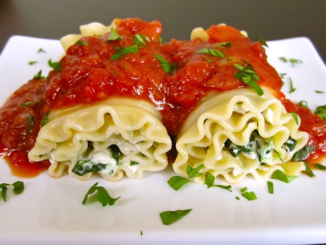 Close up of Spinach Lasagna Roll Ups plated on white plate