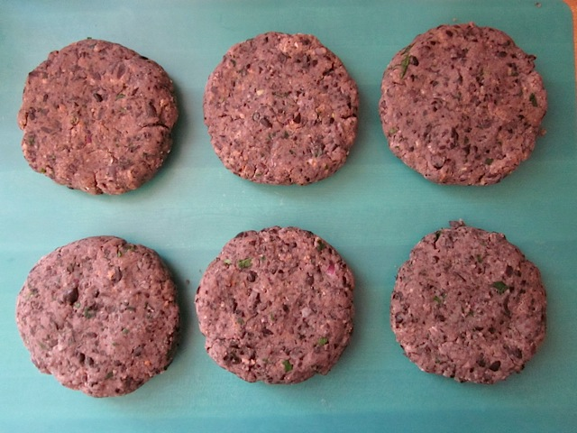 shaped bean burger patties on a cutting board