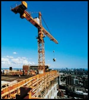 Fig. 14. The tower crane and bucket can easily handle concrete for tall-building construction.