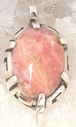ac7e31f2e307 Dije guarda pampa con rodocrosita engarzado en plata