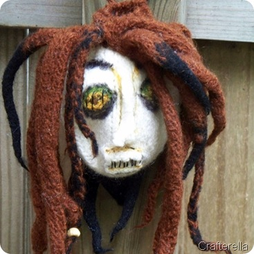 shrunken head bag embelished detail