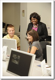 JULY 30 -- Frances Ward-Johnson, Associate Professor - Communications, photographed with students in a computer lab in McEwen Communications Building for the 2009 provost report . (Grant Halverson)