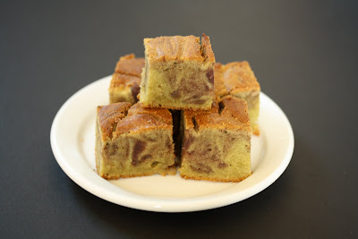 photo of slices of Green Tea Mochi Cake with Red Bean Swirl stacked on a plate