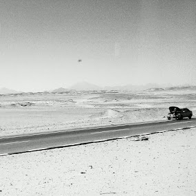 Deserted by Kajsa Karlsson - Instagram & Mobile Android ( car, luxor, desert, black and white, sahara, road, egypt, deserted )
