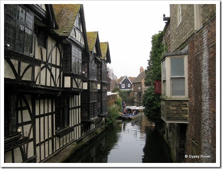 Weavers House Canterbury overlooking the river Stour and the guided boat trips. The witches ducking stool is above the white boats.