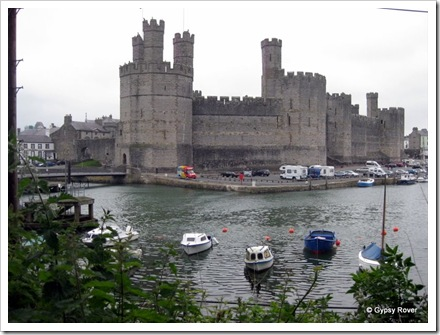 Caernarfon Castle and the harbour at high tide.
