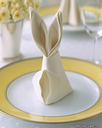 Folding napkins into this bunny shape would be a playful tabletop detail. (marthastewart.com)