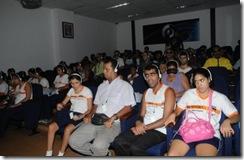 Áudio para todos: foto de uma sessão de cinema com audiodescrição