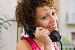 African-american woman on the phone, getting 60 second online loan approvals
