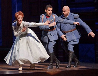 Diana Damrau as Marie, Juan Diego Flórez as Tonio, and Maurizio Muraro as Sulpice in Laurent Pelly's production of LA FILLE DU RÉGIMENT [Photo by Ken Howard]