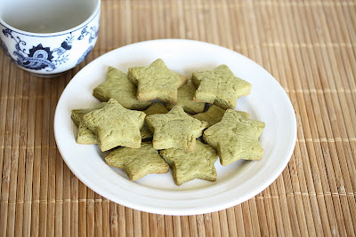 photo of a plate of star-shaped Matcha Green Tea Sugar Cookies
