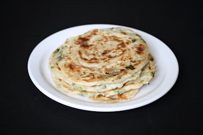 photo of Green Onion Pancakes stacked on a plate