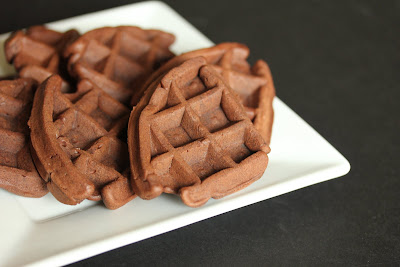 chocolate waffle cakes piled on a plate