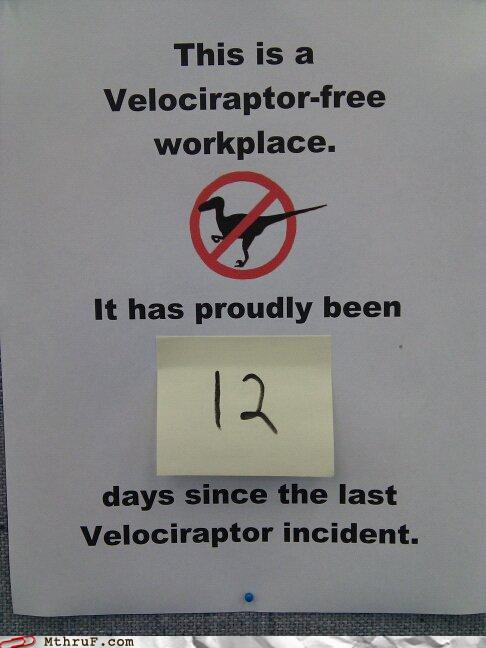 photo of Velociraptor-free workplace sign