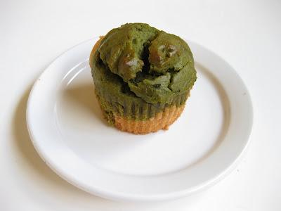 one Matcha Green Tea and White Cupcake on a white plate.