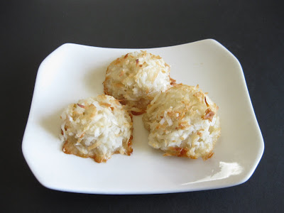 photo of three macaroons on a white plate