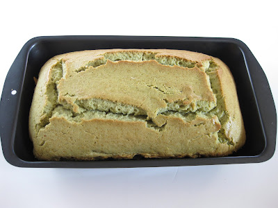 photo of a loaf of matcha green tea pound cake in a loaf pan