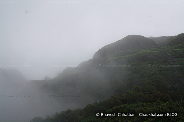 Clouds covering a hill while returning from Tamhini ghat