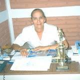 Virginia Gómez De Guillen, then headteacher of the school, won the award of best headteacher in Managua for the fifth year running - this shows Virginia with the award.