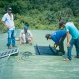 Installing the solar panel on the roof of the school